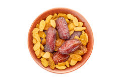 Bowl of raisins and date fruits on white Royalty Free Stock Photo