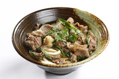 Bowl of ramen beef noodle with herbs on white background Royalty Free Stock Photography