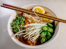 A bowl of Ramen noodle soup with vegetables. Asian Japanese food royalty free stock photo