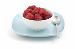 Bowl of raspberries stock image