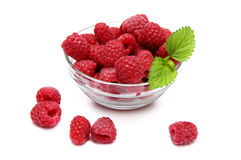 Bowl of raspberries. Glsaa bowl of raspberries  isolated on a white background Stock Photography