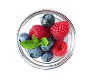 Bowl with raspberries and blueberries on white background. Bowl with fresh raspberries and blueberries on white background Stock Image