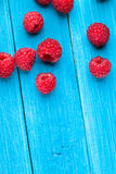 Bowl of raspberries on wooden table Royalty Free Stock Image