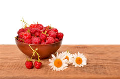 Bowl of raspberries on a wooden table Stock Photos