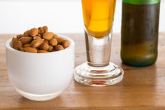 Bowl of raw almond nuts on wooden table Stock Image