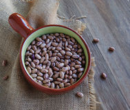 Bowl with raw beans in a rustic style Stock Images