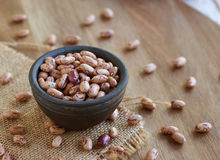 Bowl with raw beans in a rustic style Royalty Free Stock Image