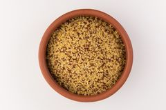 Bowl of raw bulgur and quinoa  on white background royalty free stock images