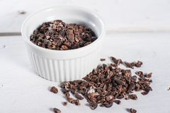 Bowl of raw cacao cocoa nibs Royalty Free Stock Photography