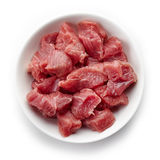 Bowl of raw diced beef meat, from above Stock Image