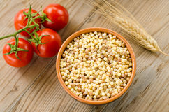 Bowl of raw fregola Stock Photography
