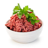Bowl of raw ground meat. Close up on isolated bowl of lean red raw ground meat Stock Photography