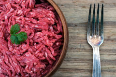 Bowl of raw mince meat and fork Royalty Free Stock Photo