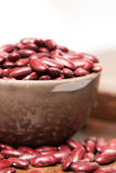 Bowl with raw red beans close up vertical Royalty Free Stock Images