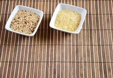 Rice. Bowl of raw rice on bamboo tablecloth background Royalty Free Stock Image