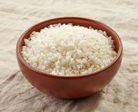 Bowl of raw round rice Stock Photos