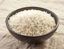 Bowl of raw round rice Royalty Free Stock Image