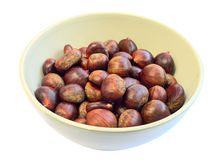 Bowl of raw sweet chestnuts Stock Image