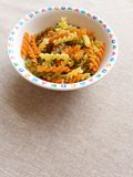 Italian Pasta in children bowl Stock Photography