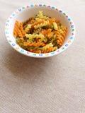 Italian Pasta in children bowl stock photography