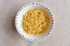 Pasta in children bowl stock images