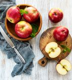 Bowl with red apples stock images