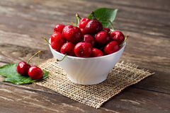 Bowl with red cherries. Freshly picked cherries concept Stock Images