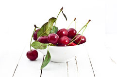 Bowl of red cherries on white Royalty Free Stock Image