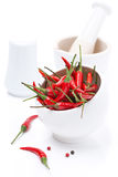 Bowl with red chili pepper isolated Stock Photos