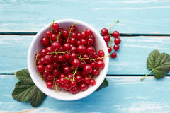 Bowl of red currant on a wooden table Royalty Free Stock Photo