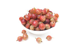 Bowl of red gooseberries isolated Stock Photos
