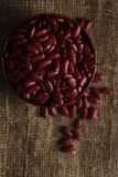 Bowl of red haricot beans on sackcloth. Stock image Royalty Free Stock Images