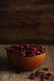 Bowl of red haricot beans on sackcloth. Stock image Royalty Free Stock Photography