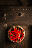 Bowl of red hot cayenne chili peppers Stock Photography