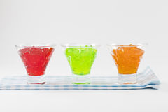 Bowl of red Jello. On blue cloth Stock Images