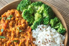 Bowl of red lentil curry with white rice and broccoli. Close up Stock Image