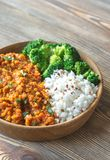 Bowl of red lentil curry with white rice and broccoli. Close up Royalty Free Stock Images