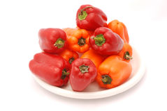 Bowl of Red and Orange Peppers Stock Images