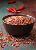 Bowl of red rice, chili peppers Royalty Free Stock Images