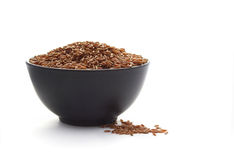 Bowl of red rice isolated on white Stock Photo
