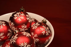 Bowl of Red Xmas Balls Royalty Free Stock Photography