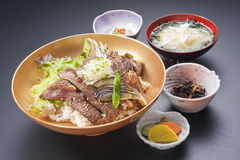 Bowl of rice with beefsteak, lettuce and soup in Japanese style Stock Photography