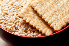 Bowl of rice and biscuits Royalty Free Stock Photos
