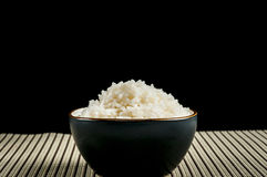 Bowl of rice. On a black back ground royalty free stock images