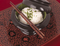 Bowl of rice and Chinese chopsticks Royalty Free Stock Photography