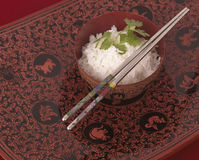 Bowl of rice and Chinese chopsticks Stock Images