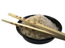 Bowl of Rice with Chop sticks Royalty Free Stock Photography