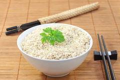 Bowl of rice and chopstick. S on the table Stock Photo
