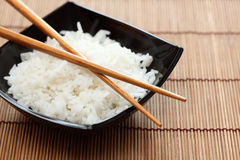 Bowl of rice with chopsticks Stock Images