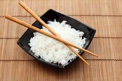 Bowl of rice with chopsticks Stock Photos